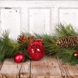 Christmas ornaments on wooden background - Stock Photo