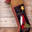 Christmas stocking with presents on wood — Stock Photo #13950069