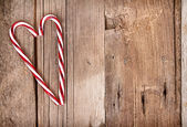 Candy canes in a heart shape — Stock Photo