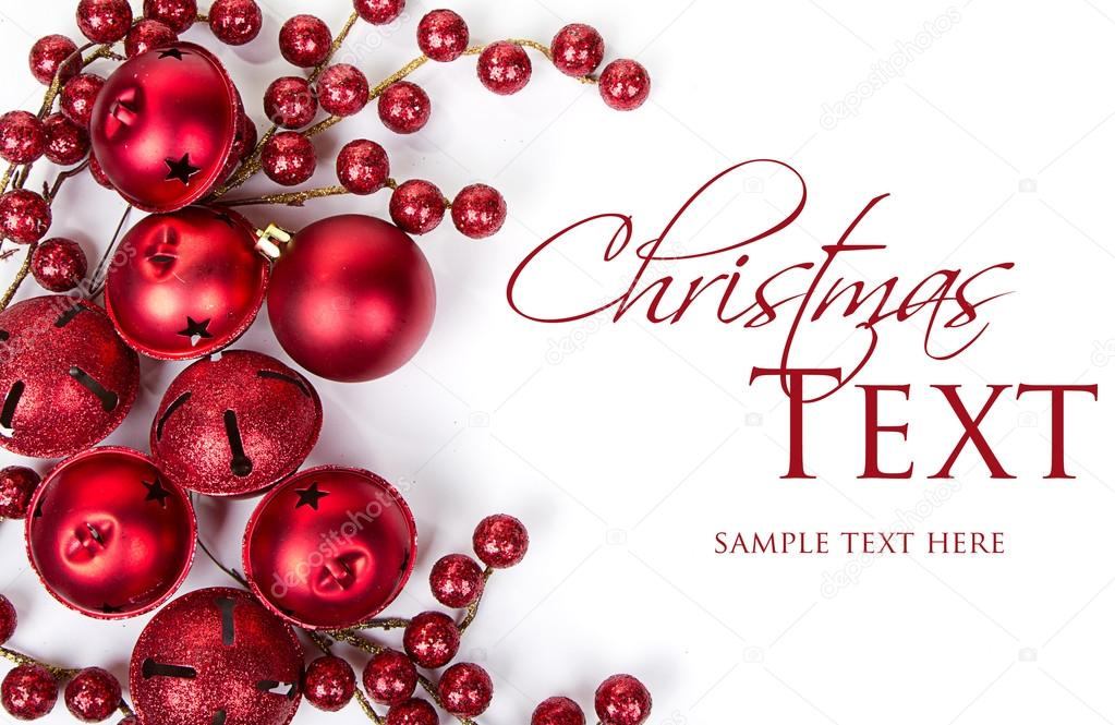 Christmas bells, ornaments and berries on white background — Stock Photo #13950540