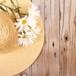 Sun hat on wooden plank — Stock Photo #17435881