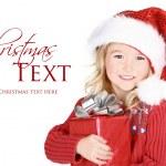 Child holding present wearing santa hat — Stock Photo #17437379