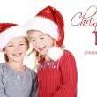 Two children wearing Santa hats — Stock Photo