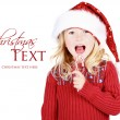 Child eating a candy cane — Stock Photo