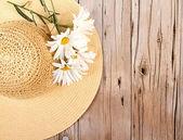 Sun hat on wooden plank — Stock Photo