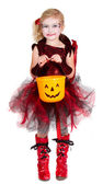 Young girl dressed in Halloween costume — Stock Photo