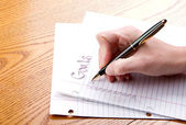 Writing goals on a paper — Stock Photo