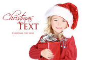 Child holding present wearing santa hat — Stock Photo