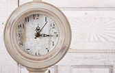 Clock on aged background — Stock Photo