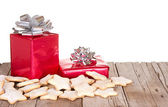 Presents and cookies on wood plank — Stok fotoğraf