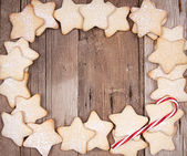 Star Christmas cookies and candy canes — Stock Photo