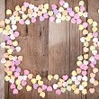 Heart shape candy on wooden plank — Stock Photo #18740857