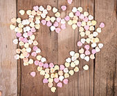 Heart shaped candy in shape of heart — Stock Photo