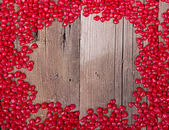Heart shape candy on wooden plank — Stock Photo