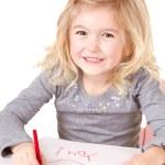 Little girl writting I love you — Stock Photo