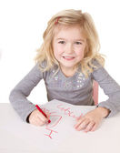Little girl writting I love you mom — Stock Photo