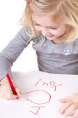 Little girl writting I love you — Stock Photo