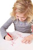 Little girl writting I love you mom — Stock Photo