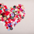 Assorted buttons in shape of heart — Stock Photo