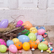 Plastic easter eggs and candy - Stock Photo