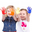 Two girls with paint on hands — Stock Photo