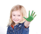 Uma criança com tinta verde na mão — Fotografia Stock
