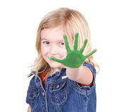 A child with green paint on her hand — Stock Photo