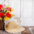 Spring flowers and straw hat — Stock Photo #24798123