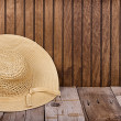 Sun hat on wooden background — Stock Photo