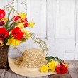 Spring flowers and straw hat — Stock Photo #24798119