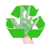 Green hands with the recycle symbol — Stock Photo