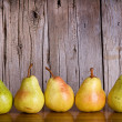 Stock Photo: Pears lined up in row