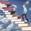 Child climbing staircase of books — Stock fotografie