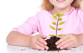Child with plant — Stock Photo