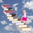 Child climbing staircase of books — Stock Photo