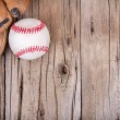 Baseball and mitt on wooden background — Stock Photo #28247873