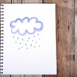 Painting of cloud and rain on notebook — Stock Photo