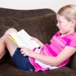 Child reading a book — Stock Photo