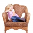 Little girl sitting on a chair — Stock Photo