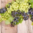 Grapes on wooden plank — Stock Photo