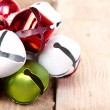 Stock Photo: Christmas jingle bells on plank