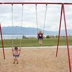 Children on swings — Stock Photo #34097237