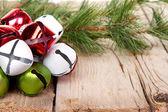 Christmas Jingle bells and a pine branch — Stock Photo