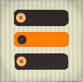 Halloween colored ribbon tags with buttons — Stock Photo