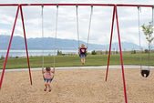 Children on swings — Stock Photo