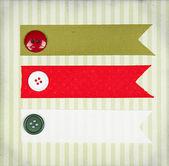 Christmas ribbon tags — Stock Photo