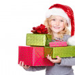 Child holding a stack of Christmas presents — Stock Photo