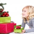 Child next to a Christmas tree — Foto Stock