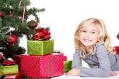 Child next to a Christmas tree — Foto de Stock