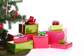 Christmas presents under a Christmas tree — Stockfoto